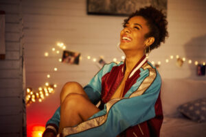 Young Black woman feeling happy after some evening self-care